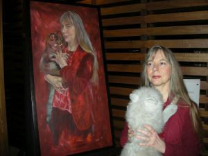 Lucy Sussex with portrait of herself by artist Dora Levakis, from the Archibald Prize's 'Salon des Refusés'
