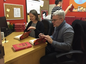Lisa signing copies of Laurus with the author, Eugene Vodolazkin, at a book event in New York